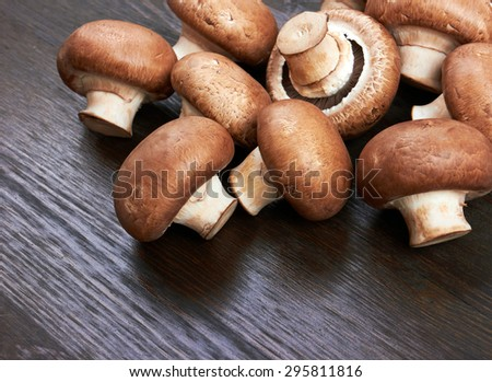 Champignon Mushroom on wood background - stock photo