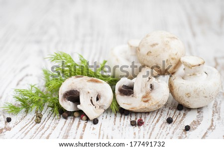 champignon mushrooms  on a old wooden background
