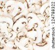 Champignon mushrooms sliced raw food pattern background - stock photo
