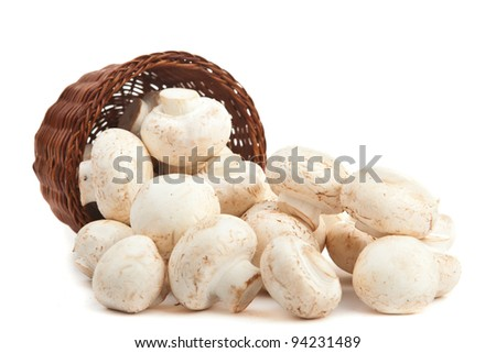 champignones in wooden basket isolated on white - stock photo