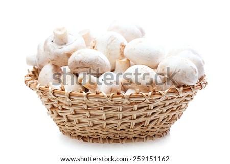 champignons mushrooms basket Isolated on white background - stock photo