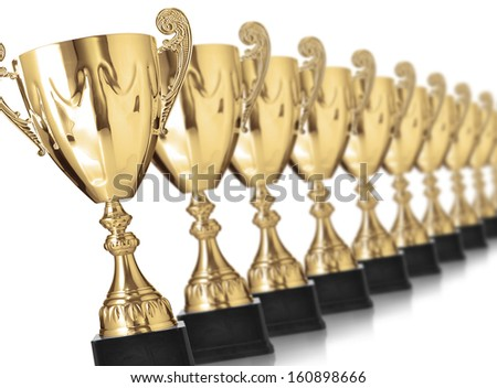 champion golden trophies isolated on white - stock photo