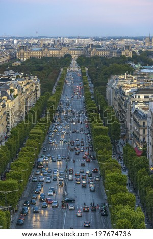 Champs-Elysees as seen from the Arc de Triomphe in Paris, France - stock photo