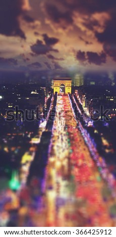 Champs Elysees at night . Blured tilt shift vintage style picture. Travel and Business background - stock photo