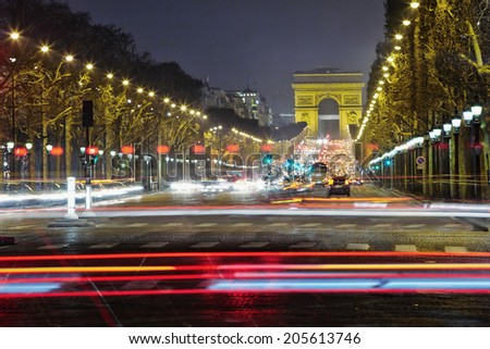 Champs-Elysees with heavy traffic at night, Paris, France - stock photo