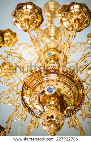 Chandelier in the church - stock photo