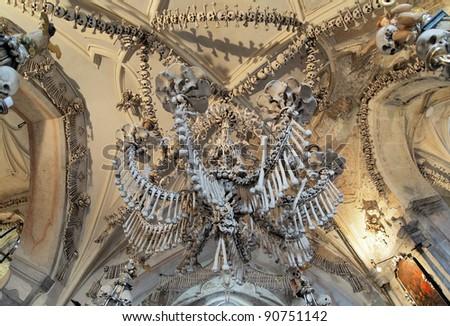 Chandelier made of bones and skulls in Sedlec ossuary (Kostnice), Kutna Hora, Czech Republic - stock photo