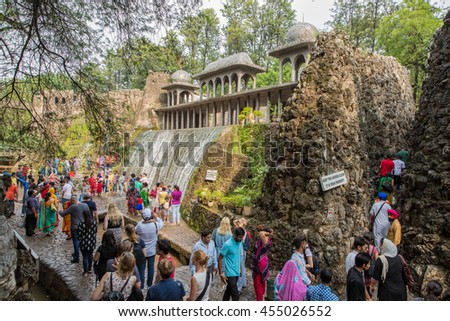 CHANDIGARH, INDIA - June 21, 2016: Visitors at the rock garden on June 21, 2016 in Chandigarh, India. Nek Chand established the garden in 1957. - stock photo
