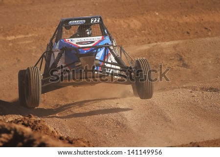 CHANDLER, AZ - OCT 26: Geoffrey Cooley (22) at speed in Pro Buggy Lucas Oil Off Road Series racing during a qualifying session on October 26, 2012 at Firebird International Raceway in Chandler, AZ. - stock photo