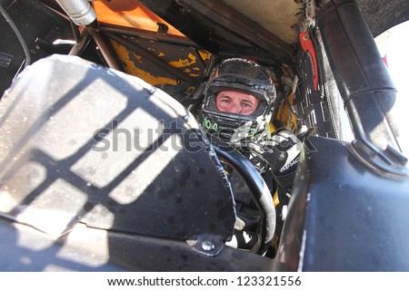 CHANDLER, AZ - OCT 26: Jerry Daugherty (23) on the grid in his Pro 4 Unlimited Lucas Oil Off Road Series racing for qualifying on October 26, 2012 at Firebird International Raceway in Chandler, AZ. - stock photo