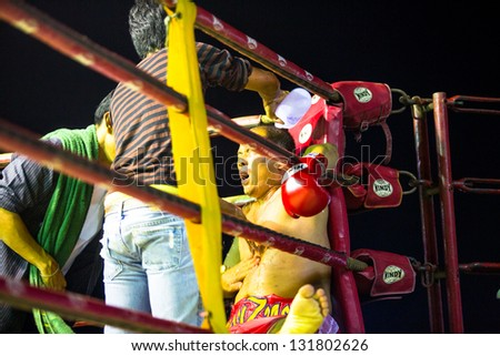 CHANG, THAILAND - FEB 22: Unidentified Muay Thai fighter compete in an amateur kickboxing match, Feb 22, 2013 on Chang, Thailand. Muay Thai practiced over 120000 fans and nearly 10000 professionals. - stock photo