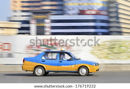 CHANGCHUN, CHINA - JAN. 31, 2014. Taxi on the road. There are 12,000 taxis in Changchun, all metered. Generally most taxis charge a base fee of Y5 for 2.5 kilometers, with Y1 for each additional kilometer. - stock photo