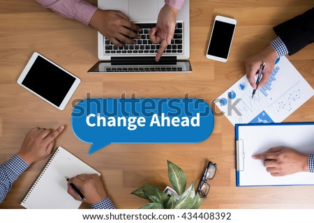 Change Ahead Business team hands at work with financial reports and a laptop, top view - stock photo