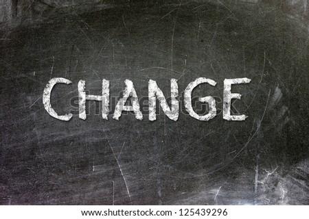 Change handwritten with white chalk on a blackboard. - stock photo