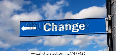 change  road sign over sky - stock photo