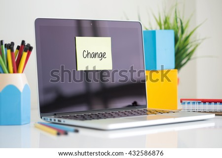 Change sticky note pasted on the laptop - stock photo