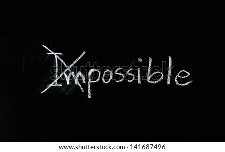 Change the word impossible to possible on blackboard. - stock photo