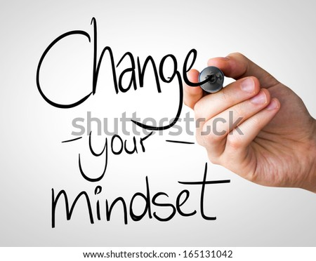 Change your Mindset hand writing with a black mark on a transparent board - stock photo
