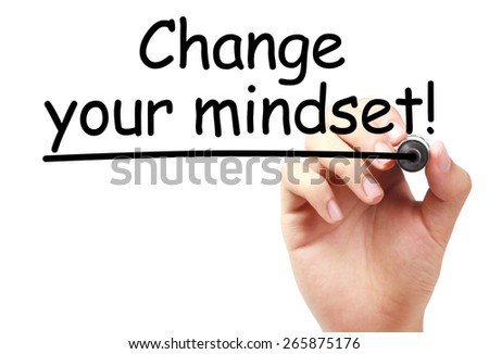 Change your mindset text is written on transparent white board by hand with marker isolated. - stock photo