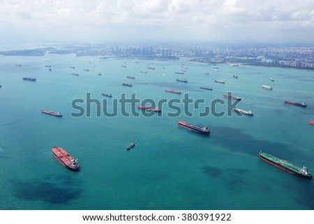 CHANGI, SINGAPORE -21 JAN 2016- Aerial view of the lines of cargo container ships waiting to enter the port of Singapore.