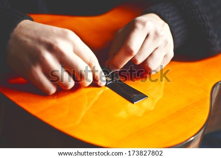 changing strings on classic guitar