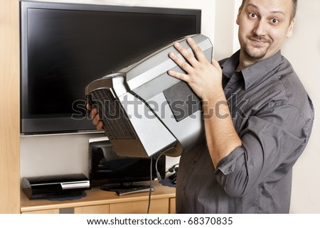 changing the old TV for a new LCD TV - stock photo