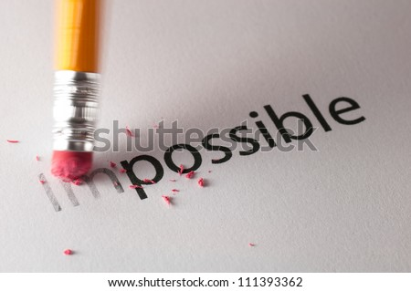 Changing the word impossible to possible. - stock photo