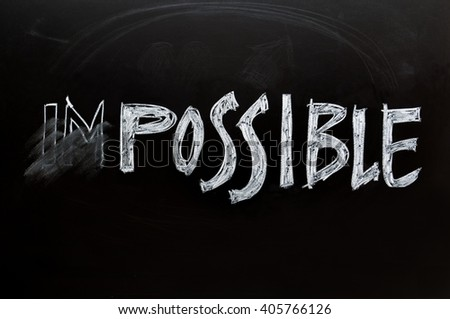 Changing the word impossible to possible text hand writing of chalk on blackboard background. - stock photo
