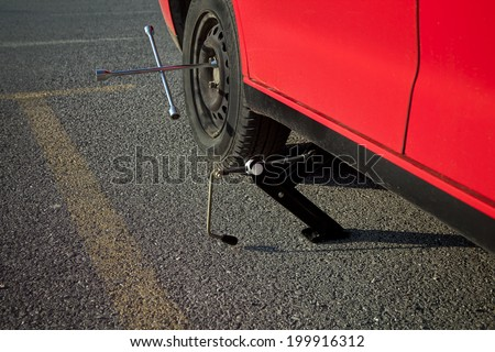 Changing tire - stock photo