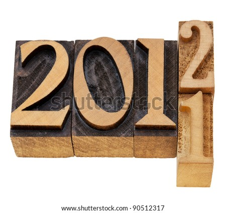 changing years 2011 and 2012 - isolated numbered in vintage wood letterpress printing blocks - stock photo