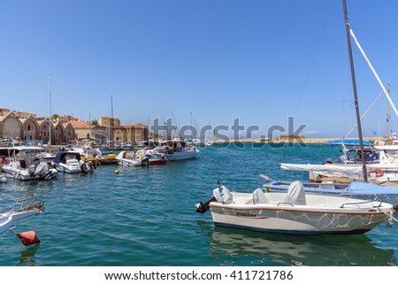 CHANIA, CRETE, GREECE - AUGUST 17, 2015: Chania harbour with yachts and fishing boats on Crete island.