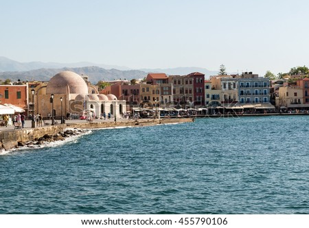 CHANIA, GREECE - JULY 9, 2016: Tavernas and restaurants surrounding the harbour of Chania, Crete, Greece