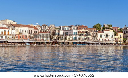 CHANIA, GREECE - JULY 1, 2008: The harbour of Chania in the early morning in soft morning light before the town fills with tourists and locals.
