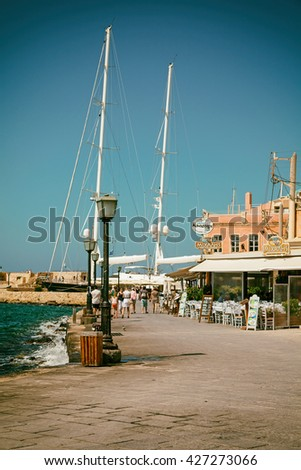 Chania (Hania) Town, Crete Island, Greece - June 16, 2013: Venetian harbour and moored yachts - vintage stylized - stock photo
