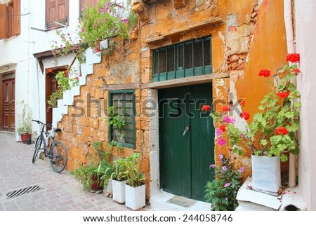 Chania, town on Crete island in Greece. Old town architecture with flowers. - stock photo