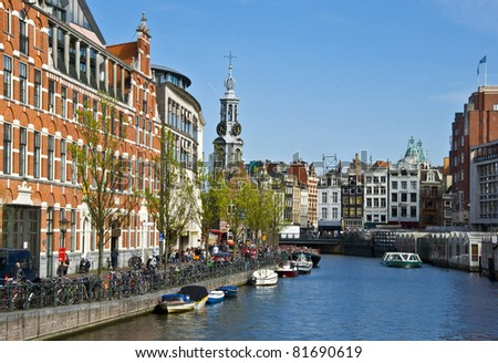 Channels in Amsterdam. Typical Amsterdam architecture. Floating Flower Market. Urban space in the spring. - stock photo