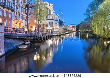 Channels in Amsterdam. Typical Amsterdam architecture on a spring night. - stock photo