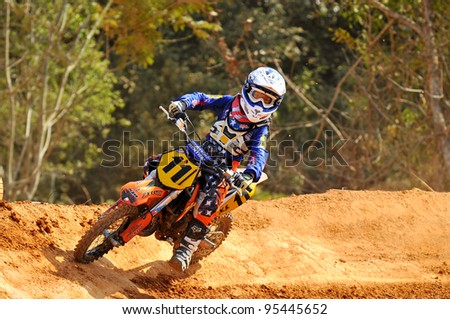 CHANTABURI, THAILAND - NOV 20: An unidentified rider participates in the final round of the 2011 Thailand motocross championship on November 20, 2011 in Chantaburi, Thailand.