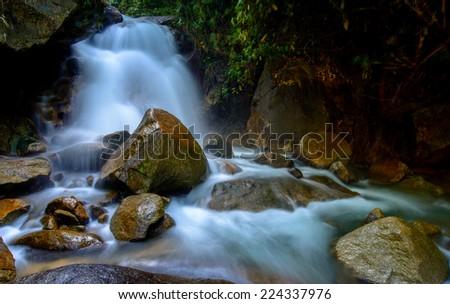 Chanthaburi .Krating Waterfall.Water flowing over rocks coastline. - stock photo