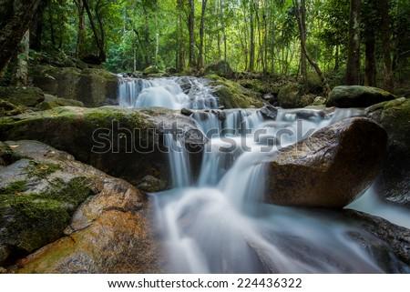 Chanthaburi Krating Waterfall.Water flowing over rocks coastline. - stock photo