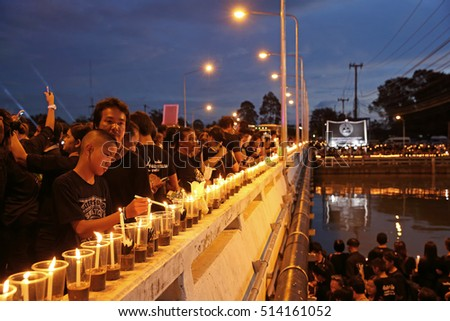 CHANTHABURI, THAILAND - NOV 9: Peoples mourners hold candles sing a song for King Bhumiphol at Khlong Phakdee Ramphai on November 9, 2016. The King's Project aiming to solve the flood in Chanthaburi