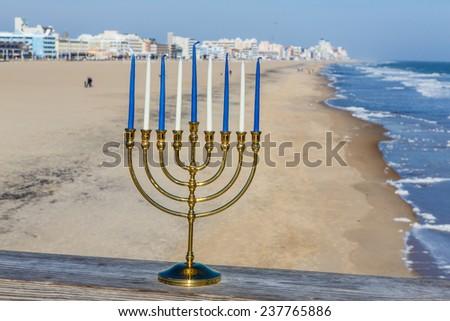 Chanukah Menorah at the beach  - stock photo
