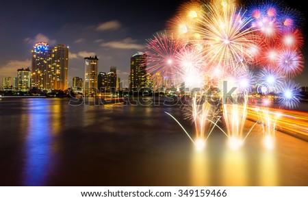 Chao Phraya River night scene with  beautiful  fireworks city view at Bangkok Thailand - stock photo