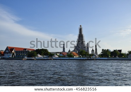 Chaophraya River in front Wat Arun and blue sky, Temple of Dawn, Bangkok, central of Thailand  - stock photo