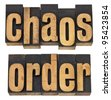 chaos and order  - a collage of isolated words in vintage letterpress wood type - stock photo