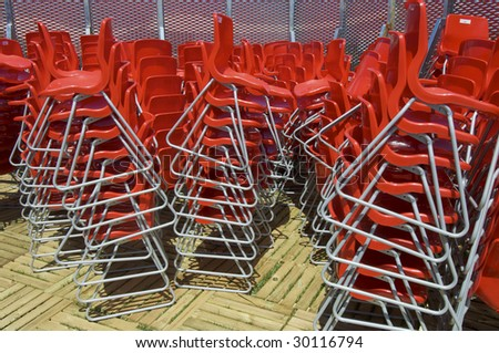 chaos of chairs stacked red