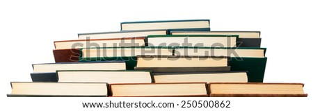 Chaotic pile of old books bottom view isolated on white background - stock photo