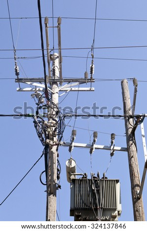 Chaotic power lines and transformer in Greece - stock photo