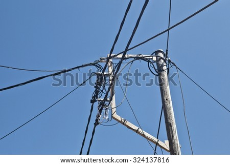 Chaotic power lines in Greece - stock photo
