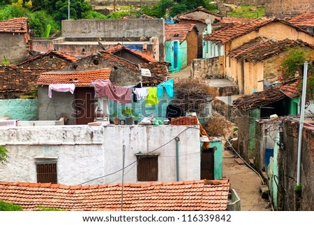 Chaotic slums in indian city of Chittorgarh - stock photo
